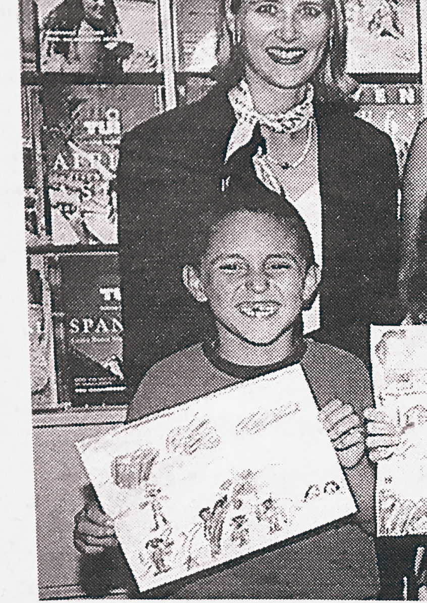 23th juli 1997 - Winner of a painting competition. Photo of the local newspaper